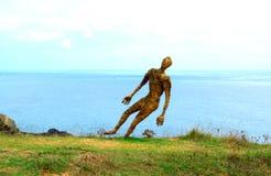 Man at high coast edge. Straw man sculpture at the seashore edge  hanging over the sea,Sinemorets,Black Sea coast,Bulgaria Stock Photos