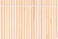 A straw mat. Straw twigs tied with a rope on a white background. View from the top Royalty Free Stock Photo