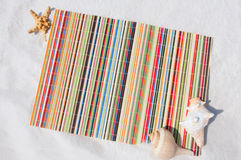 Straw mat on beach Royalty Free Stock Photo