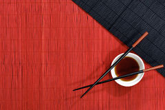 Straw mat and chopsticks Stock Photos