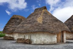 Straw Neolithic Houses. In England Stock Photos