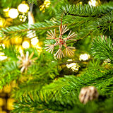 Straw Ornament in a real Christmas tree Royalty Free Stock Image
