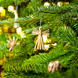Straw Ornament in a real Christmas tree Stock Photography