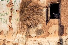 Straw outside of a hut in Ghana. Straw dries outside of a hut in a village in Ghana stock images