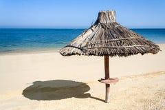 Straw parasol. On the beach of Ifaty, western Madagascar Royalty Free Stock Photo