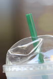 Straw and plastic glass Royalty Free Stock Photos