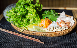 Straw plate with ingredients for vietnamese spring rolls Royalty Free Stock Photography