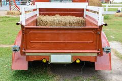Straw in red truck Stock Images