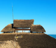 Straw roof. Antenna on the straw roof Stock Photography