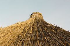 Straw roof. Top of the reed roof at sunny day Stock Photography