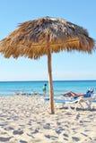 Straw roof of beach umbrella on white sandy beach Stock Photos