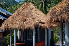 Straw roof bungalows on a beach on Royalty Free Stock Image