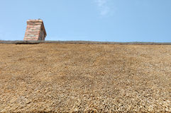 Straw roof and chimney Royalty Free Stock Images
