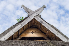 Straw roof with wooden birds as decoration Royalty Free Stock Photos