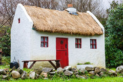 Straw roofed cottage Stock Image