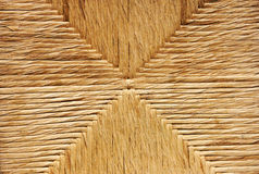 Straw rope regular chair background stock images