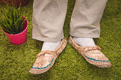 Straw sandals on a green background Stock Photography