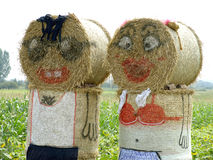 Straw sculpture. A family made out of straw bales Royalty Free Stock Photo