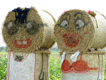 Straw sculpture. A family made out of straw bales Royalty Free Stock Images