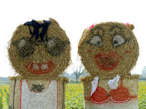 Straw sculpture. A family made out of straw bales Royalty Free Stock Photography