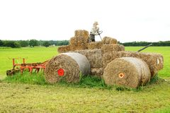 Straw sculpture - tractor with plow Royalty Free Stock Image