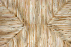 Straw seat texture. Golden yellow straw chair cushion texture stock photo