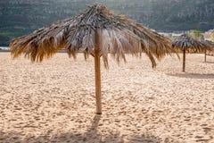 Straw shade umbrella Royalty Free Stock Image