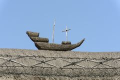 Straw ship on straw roof  at Porlock, Somerset. Detail of straw roof  in historic touristic village of  Somerset. Shot in bright light Stock Image
