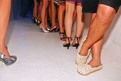 Straw shoes in the night club. royalty free stock photo