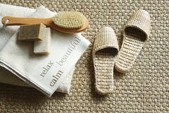 Straw slippers with spa accessories Royalty Free Stock Photography