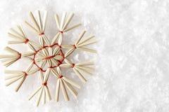 Straw Snowflake on White Snow, Christmas Strawy Snow Flake Royalty Free Stock Photos