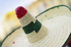 Straw sombrero close-up with red and green decorated, texture. Straw sombrero close-up with red and green decorated, selective focus stock photography