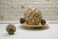 Straw spheres in kitchen still-life Stock Image