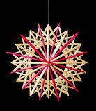 Straw star Christmas decoration over black Royalty Free Stock Images