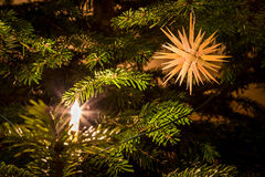 Straw star on Christmas Tree Royalty Free Stock Photography