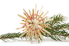 Straw star in front of a branch Stock Image