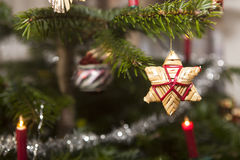 Straw stars on a christmas tree Royalty Free Stock Photo