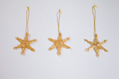 Straw stars, white background, copy space Royalty Free Stock Images
