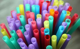 Straw straws plastic drinking background colourful  full screen single use pollution. Copy space Stock Photos