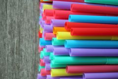 Straw straws plastic drinking background colourful  full screen single use pollution. Copy space Royalty Free Stock Image