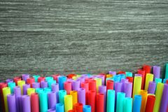 Straw straws plastic drinking background colourful  full screen single use pollution. Copy space Stock Photo