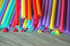 Straw straws plastic drinking background colourful  full screen single use pollution. Copy space Royalty Free Stock Images