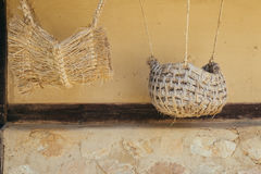 Straw string bag with Korean traditional old ocher wall Royalty Free Stock Photography