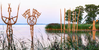Straw stubble sculptures in the river creek. Juodkrante village Stock Photography