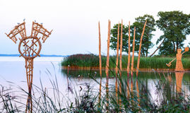 Straw stubble sculptures in the river creek. Juodkrante village Royalty Free Stock Photo