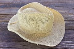 Straw summer hat on wooden background Stock Photo