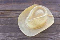 Straw summer hat on wooden background Stock Images