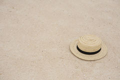 Straw sun hat in the sand Stock Photography