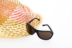 Straw, sunglasses. Isolated on white background stock images