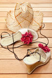 Straw sunhat and sandals Royalty Free Stock Images